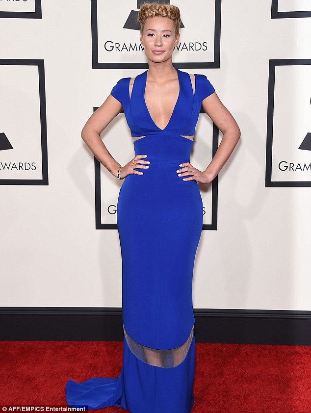 Iggy Azalea brushed off the intrusion of privacy by a Papa John's delivery driver to appear at the Grammys on Sunday night in LA where she missed out on getting an award