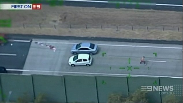 He continued to run across the motorway after being hit by a black car, still fleeing from police