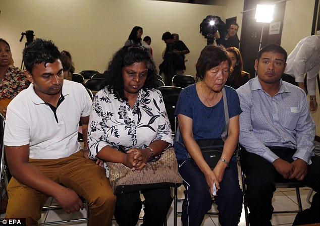 Raji Sukumaran, the mother of death-row prisoner Myuran Sukumaran, her son Chintu Sukumaran (far left), is pictured with Helen Chan (second from right), the mother of fellow death-row inmater Andrew Chan, and her son Michael Chan (far right) during a visit at the national human rights commission in Jakarta