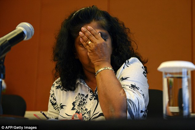 Raji Sukumaran, mother of convicted Australian drug-smuggler, Myuran Sukumaran, reacts after making an emotional appeal to Indonesian authorities not to carry out the execution of her son during a media conference in Jakarta on Monday. The mothers of the two Australians facing the executive begged authorities to 'spare our sons' lives', as their lawyers revealed plans for a last-gasp legal bid