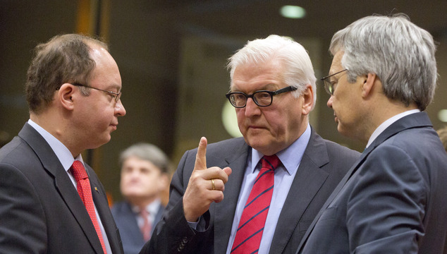 German Foreign Minister Frank-Walter Steinmeier, center, speaks with Belgian Foreign Minister Didier Reynders, right, and Romanian Foreign Minister Bogdan Au...