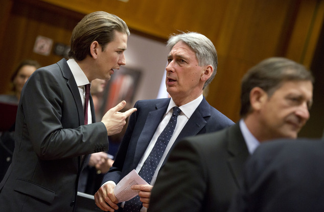 Austrian Foreign Minister Sebastian Kurz, left, speaks with British Foreign Minister Philip Hammond during a meeting of EU foreign ministers at the EU Counci...