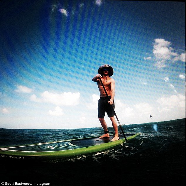 Outdoorsy: Scott said he was 'proud to be the face of the fragrance that is synonymous' with the ocean. He previously shared this picture of himself in Hawaii, writing, 'Training in full swing. 8 mile ocean paddle, surf, deep sand runs. Good day to be alive'