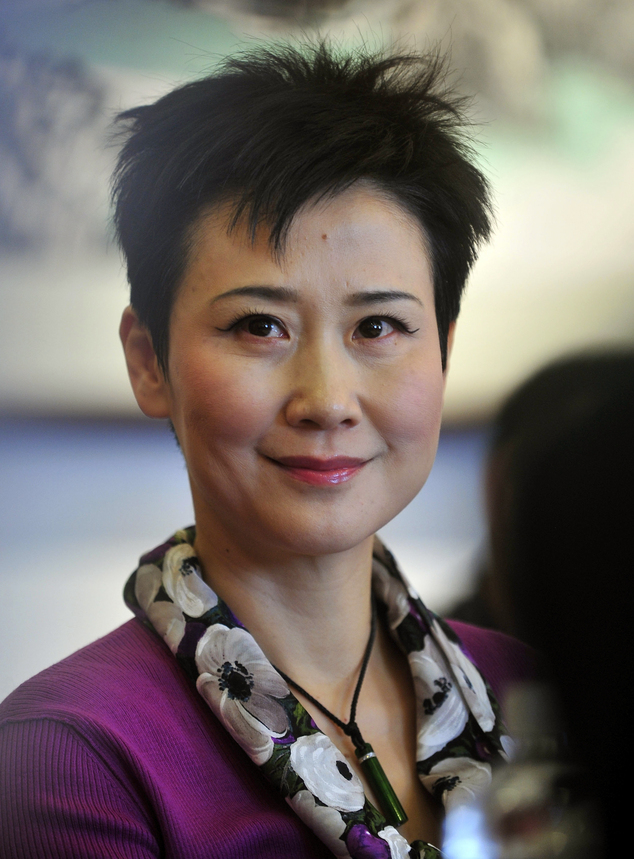 In this March 4, 2011 photo, Li Xiaolin, chairwoman of the state-owned electricity giant China Power International Development Ltd., attends the Chinese Peop...
