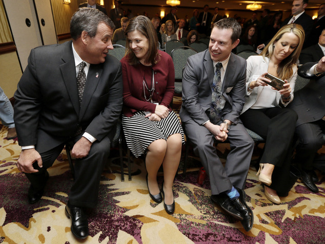 New Jersey Gov. Chris Christie, left, talks with Kellie Paschke before speaking at the Dallas County Republicans' Spring Speaker Series, Monday, Feb. 9, 2015...