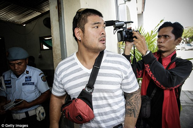 Andrew Chan's brother Michael arrives to visit his brother on February 10. The families have been visiting frequently following the government's announcement that the two men on death row will be killed this month