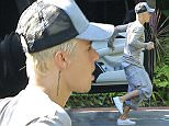 UK CLIENTS MUST CREDIT: AKM-GSI ONLY EXCLUSIVE: Beverly Hills, CA - Justin Bieber returns to Los Angeles after his naked pictures emerged while vacationing in Bora Bora with model Jayde Pierce, 20. Twitter was temporarily swept away in a cataclysmic cloud! Today the Popstar returned to work and can be seen here arriving at a local Studio in L.A.