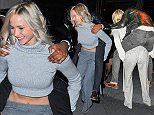 Jennifer Lawrence carries Aziz Ansari to his car after Saturday Night Live After Party at The Wayfarer Restaurant in New York\n\nPictured: Jennifer Lawrence, Aziz Ansari\nRef: SPL1146887  111015  \nPicture by: JosiahW / Splash News\n\nSplash News and Pictures\nLos Angeles: 310-821-2666\nNew York: 212-619-2666\nLondon: 870-934-2666\nphotodesk@splashnews.com\n