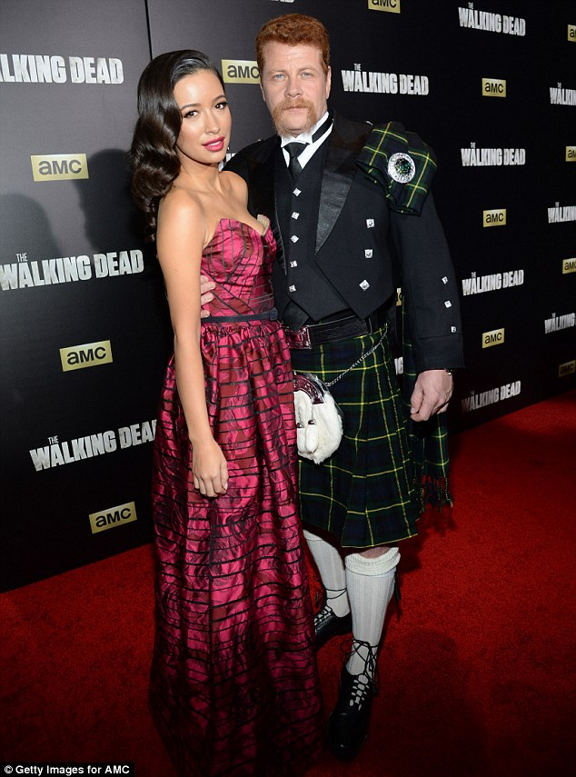 Cozy co-stars: Christian and her Walking Dead co-starMichael Cudlitz attended the season six fan premiere