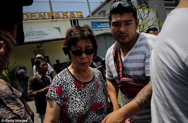 Australian Halen Chan (L), the mother of death-row prisoner Andrew Chan, and brother Michael Chan (R), leave after visiting Andrew at Kerobokan Prison on February 10 in Denpasar, Bali