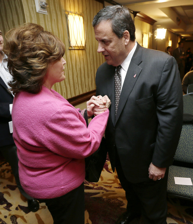 New Jersey Gov. Chris Christie talks with Sherill Whisenand, left, of West Des Moines, Iowa, before speaking at the Dallas County Republicans' Spring Speaker...