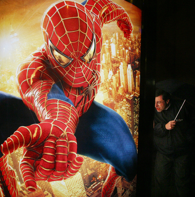 """FILE - In this Nov. 11, 2004, file photo, a man looks at an advertisement for the """"Spider-Man"""" movie in Copenhagen, Denmark. Sony and Marvel/Disney announced..."""