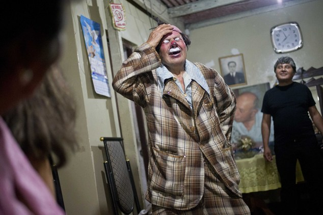 "In this Feb. 7, 2015 photo, veteran clown Ricardo Farfan, popularly known as ""Pitito,"" performs during his 91st birthday party at his home in Lima, Peru. Far..."