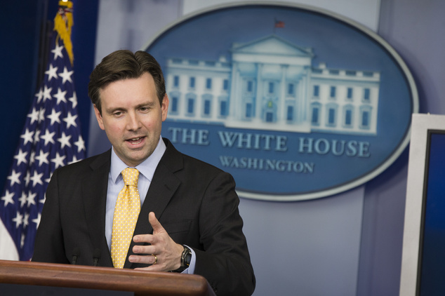 White House press secretary Josh Earnest answers a question on the death of Kayla Mueller, the last known American hostage of the Islamic State group, during...