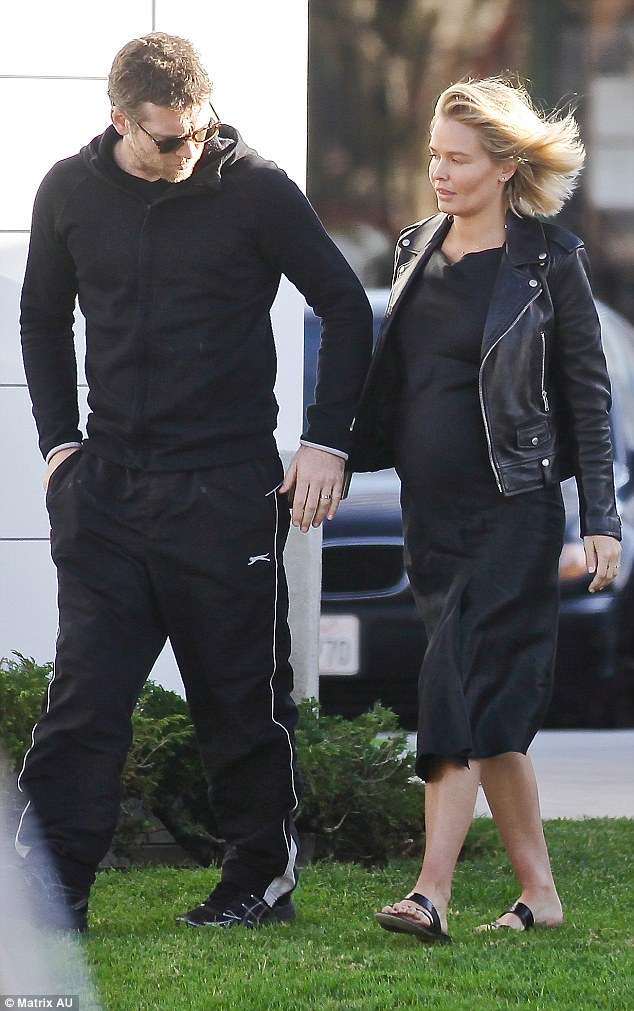 The look of love: Understandably Lara's partner, actor Sam Worthington, couldn't take his eyes off his stunning other half