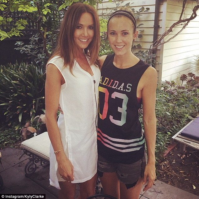 The stylish WAGs: Cricket's first lady Kyly Clarke, 33, was the picture of casual elegance in a white zip-up mini dress, while close chum Bec Hewittdressed casually in a singlet and ripped shorts