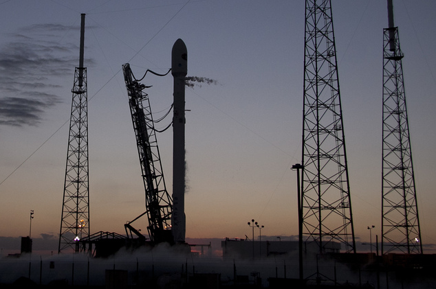 In this Sunday, Feb. 8, 2015 photo, a Falcon 9 SpaceX rocket stands at complex 40 moments before a launch attempt was scrubbed at the Cape Canaveral Air Forc...