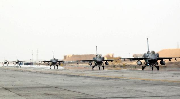 A picture released by the official Jordanian news agency, PETRA, on February 8, 2015 shows a squadron of United Arab Emirates F-16 fighters arriving in one o...