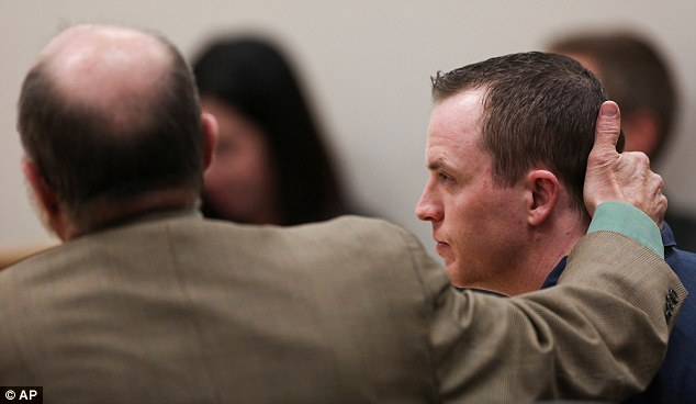 Defense attorney Ron Yengich comforts Conrad Truman during his sentencing where he was ordered to spend life in prison for his wife's murder