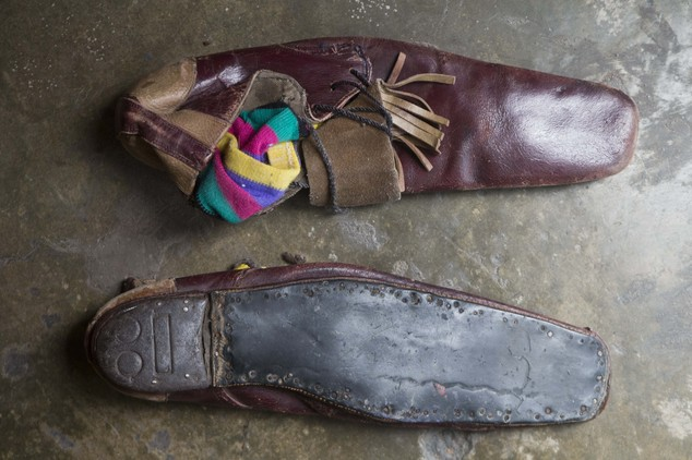 "In this Feb. 6, 2015 photo, a pair of clown shoes belonging to veteran clown Ricardo Farfan, popularly known as ""Pitito,"" sit in his home in Lima, Peru. Farf..."