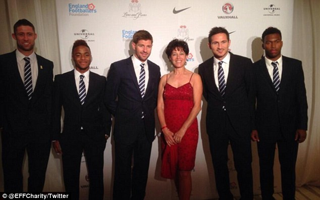 All smiles: England stars (from left to right) Gary Cahill, Raheem Sterling, Steven Gerrard, Frank Lampard and Daniel Sturridge pose with Bobby Moore's widow Stephanie at the England Footballers Foundation charity dinner on Sunday night