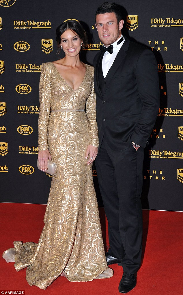 Family man: Police said Burgess had 'bloodshot and watery eyes and smelled strongly of intoxicating beverage' when arrested. Pictured here with partner Yolanda Hodgsonin 2013
