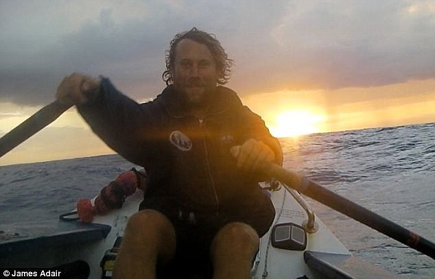 Beautiful: Mr Stenning smiles in front of the setting sun as he smiles for the camera after a hard day's rowing