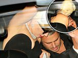 Lady Gaga looks to make out with boyfriend Taylor Kinney as their Rolls Royce pulls to the sidewalk next to their apartment.\n\nPictured: Lady Gaga, Taylor Kinney\nRef: SPL1148993  111015  \nPicture by: XactpiX/splash\n\nSplash News and Pictures\nLos Angeles: 310-821-2666\nNew York: 212-619-2666\nLondon: 870-934-2666\nphotodesk@splashnews.com\n