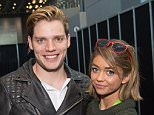 """NEW YORK, NY - OCTOBER 10:  Actors Dominic Sherwood (L) and Sarah Hyland pose in the press room for """"Shadowhunters"""" during New York Comic-Con Day 3 at The Jacob K. Javits Convention Center on October 10, 2015 in New York City.  (Photo by Michael Stewart/Getty Images)"""