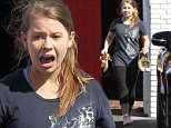 Hollywood, CA - DWTS contestant Bindi Irwin steps outside in socks and yelps in pain as she realizes how hot the pavement is.  The pretty blonde is ending a day of rehearsals as her mother, Terri, picks her up at practice. \nAKM-GSI        October 10, 2015\nTo License These Photos, Please Contact :\nSteve Ginsburg\n(310) 505-8447\n(323) 423-9397\nsteve@akmgsi.com\nsales@akmgsi.com\nor\nMaria Buda\n(917) 242-1505\nmbuda@akmgsi.com\nginsburgspalyinc@gmail.com