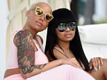 ***MANDATORY BYLINE TO READ INFPhoto.com ONLY***..Amber Rose wears a cleavage-baring dress while gal pal Blac Chyna goes completely braless in a sheer top to relax by the pool in Miami Beach.....Pictured: Amber Rose; Blac Chyna..Ref: SPL930291  170115  ..Picture by: INFphoto.com....