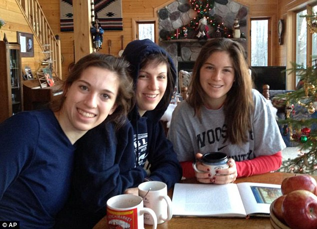 Found: This undated family photo released by the Teton County Sheriff's Office in Wyoming shows Megan Margaret Andrews-Sharer, center, with sisters, Erin, right, and Kelsi, who were found alive Thursday, two days after they failed to return from a camping trip