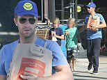 EXCLUSIVE: Chris Martin goes grocery shopping with his son Moses and his friend in Malibu  Pictured: Chris Martin Ref: SPL1148935  111015   EXCLUSIVE Picture by: Reefshots / Splash News  Splash News and Pictures Los Angeles: 310-821-2666 New York: 212-619-2666 London: 870-934-2666 photodesk@splashnews.com