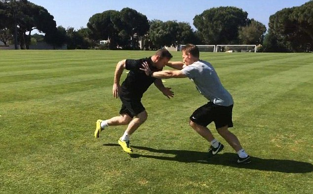 Getting fit: Rooney (left) is already in Portugal where he has been doing fitness work