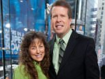 """NEW YORK, NY - MARCH 11:  Jim Bob Duggar (R) and wife Michelle Duggar visit """"Extra"""" at their New York studios at H&M in Times Square on March 11, 2014 in New York City.  (Photo by D Dipasupil/Getty Images for Extra)"""