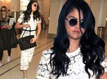 EXCLUSIVE: Selena Gomez looks stunning as she is spotted for the first time since reports that she had chemotherapy as a result of her Lupus diagnosis.  The adorable singer/actress/model was seen in a tight long dress & white heels while carrying her Louis Vuitton purse & her iPhone 6 as she was escorted to her gate by a bodyguard.  \n\nPictured: Selena Gomez\nRef: SPL1148244  091015   EXCLUSIVE\nPicture by: Sharky / Splash News\n\nSplash News and Pictures\nLos Angeles: 310-821-2666\nNew York: 212-619-2666\nLondon: 870-934-2666\nphotodesk@splashnews.com\n