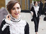 Picture Shows: Lily Collins  October 12, 2015    Actress Lily Collins is seen leaving the Saachi Gallery after viewing the Mademoiselle Priv» exhibition in London, England.    The lithe starlet showed off her simple style in a monochrome ensemble that included a black long-sleeved top adorned with white lace ruffles, cropped black trousers and white high heels with a pointed toe.    Non Exclusive  WORLDWIDE RIGHTS    Pictures by : FameFlynet UK © 2015  Tel : +44 (0)20 3551 5049  Email : info@fameflynet.uk.com