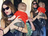 Please contact X17 before any use of these exclusive photos - x17@x17agency.com   PREMIUM EXCLUSIVE - Sofia Vergara stopped by Saks Fifth Avenue with friends and looked happy holding their infant baby.  The Modern Family star recently got married and maybe considering startinga  family of her own. Saturday, October 10, 2015 X17online.com
