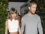 Taylor Swift and DJ Boyfriend Calvin Harris were all smiles as they left their romantic dinner at 'Giorgio Baldi' Italian Restaurant in Santa Monica, CA. Taylor was carrying a Pink designer handbag with a Cat's face on it....Pictured: Taylor Swift, Calvin Harris..Ref: SPL1098746  110815  ..Picture by: SPW / Splash News....Splash News and Pictures..Los Angeles: 310-821-2666..New York: 212-619-2666..London: 870-934-2666..photodesk@splashnews.com..
