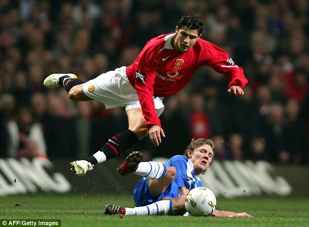 Getting stuck in: Bullard brings down Manchester United's Cristiano Ronaldo during the 2006 Carling Cup final
