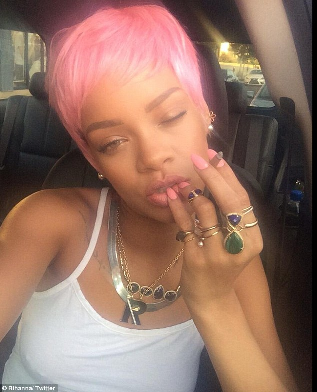 Wig-ging out: RiRi showed off her pink wig for the first time on Thursday