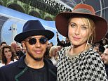 Mandatory Credit: Photo by WWD/REX Shutterstock (5215168ar)  Lewis Hamilton and Maria Sharapova  Chanel show, Spring Summer 2016, Paris Fashion Week, France - 06 Oct 2015