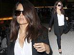 Los Angeles, CA - Actress, Salma Hayek arrives at LAX in a black pant suit, white blouse, and  black peep-toe high heels. AKM-GSI         October 11, 2015 To License These Photos, Please Contact : Steve Ginsburg (310) 505-8447 (323) 423-9397 steve@akmgsi.com sales@akmgsi.com or Maria Buda (917) 242-1505 mbuda@akmgsi.com ginsburgspalyinc@gmail.com