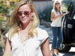 Picture Shows: Reese Witherspoon  October 10, 2015    Reese Witherspoon goes to visit a friend in Los Angeles, California.     While stopped at a red light, she took the time to give money to a homeless person.     Exclusive - All Round  UK RIGHTS ONLY    Pictures by : FameFlynet UK © 2015  Tel : +44 (0)20 3551 5049  Email : info@fameflynet.uk.com
