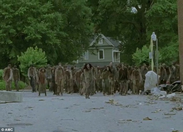 Never dead: Amidst all this drama, they still have to deal with swarms of walkers