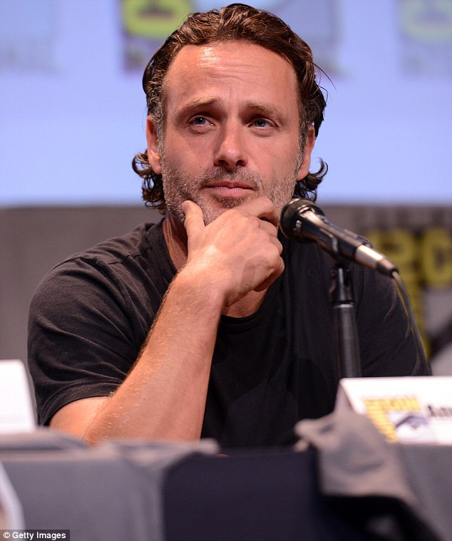 Leading man: Andrew looked pensive during the event as he sported his signature salt and pepper scruff