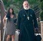 Fr. George Passias and Edith Bouzalas leaving St. Spyridon Greek Orthodox Church lin Washington Heights in New York City  in 2013.