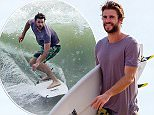EXCLUSIVE TO INF...October 12, 2015: Liam Hemsworth rides some waves at Malibu beach, California showing off his surfing skills along with his brother Luke and friends...Mandatory Credit:  SAA/Borisio..Ref:infusla-302/277