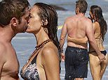 Picture Shows: Morgan Brown, Gerard Butler  October 12, 2015\n \n '300' actor Gerard Butler enjoys a day at the beach in Malibu, California with his girlfriend Morgan Brown and friends. The happy couple, who have been dating for over a year, were all smiles and packed on the PDA during the day of fun. \n \n Non Exclusive\n UK RIGHTS ONLY\n \n Pictures by : FameFlynet UK © 2015\n Tel : +44 (0)20 3551 5049\n Email : info@fameflynet.uk.com