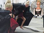"""Poppy Delevingne is spotted arriving home at 3pm this afternoon , making the """"Dash of Shame """" barefoot and using her drivers coat to hide the fact that she is still in last nights clothes. ( that she was spotted in attending the CHANEL party last night ) . Poppy is seen giggling as she realises that she has been caught out ."""